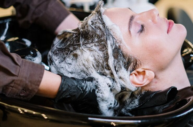 person-washing-woman-s-hair-3993449